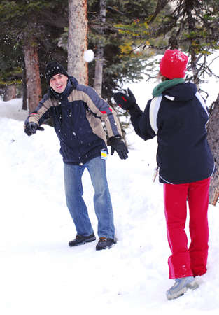 Father and chid throwing snowballs at winter park Stock Photo - 1439193