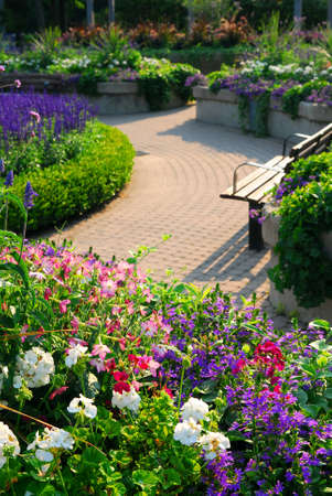 Formal garden with blooming flowers in the summer photo
