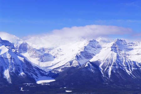 Snowy mountain ridge at Lake Louise in Canadian Rockies in winter photo