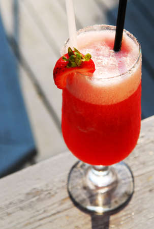 served: Cold strawberry daiquiri beverage served on an outdoor patio