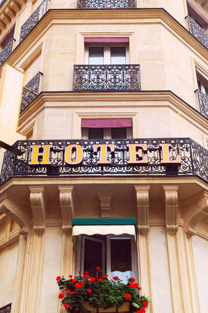 hotel: Hotel building with wrought iron balconies in Paris, France
