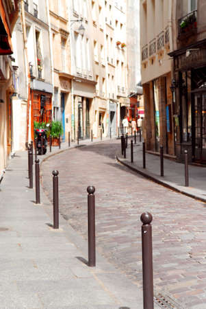 cobblestone street: Small street with cobblestone pavement in historic center of Paris, France