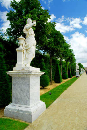 Statue on a path of Versailles garden, France photo