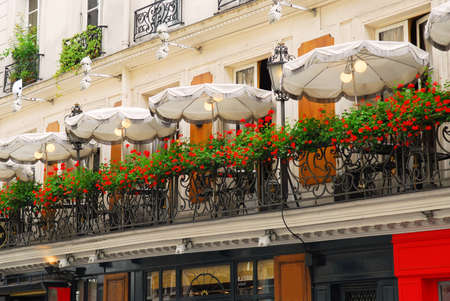 balcony: Paris cafe with a balcony patio and umbrellas