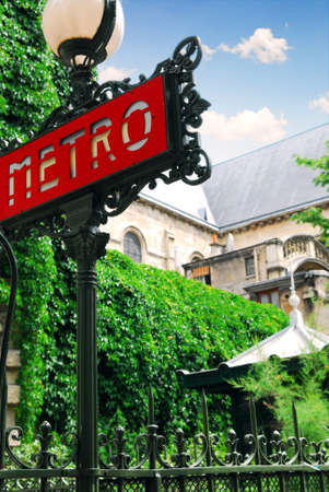 Metro sign at Saint Germain de Pres cathedral in Paris, France photo
