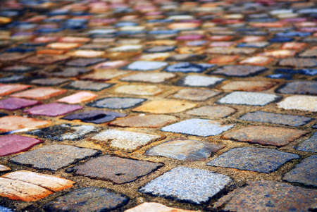 Background of colorful cobblestone pavement close up photo