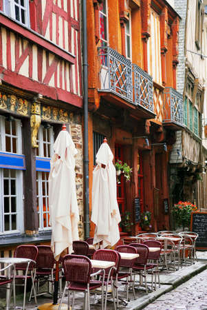 street cafe: Old medieval half-timbered houses in Rennes, France. Stock Photo