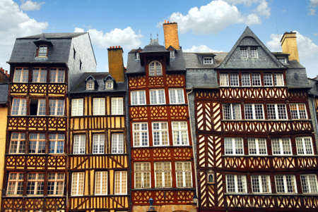 tilt views: Row of crooked medieval houses in Rennes, France.
