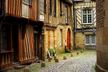 Medieval street with half-timebered houses in Rennes, France.