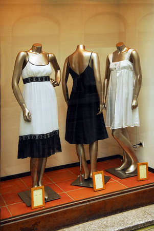 displaying: Boutique display window with mannequins in fashionable dresses Stock Photo