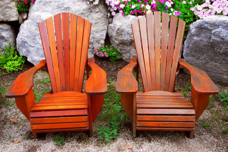 patio chairs: Two solid wood patio chairs and natural stone landscaping