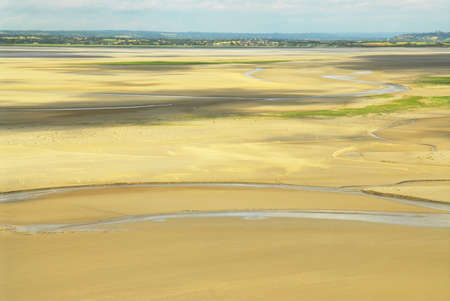 Ocean at low tide viewed from Mont Saint Michelle abbey, France Stock Photo - 1620931