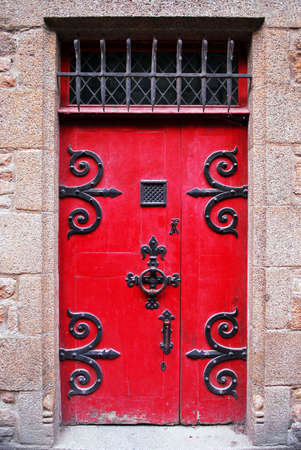 Red medieval door in Mont Saint Michel abbey in France Stock Photo - 1620939