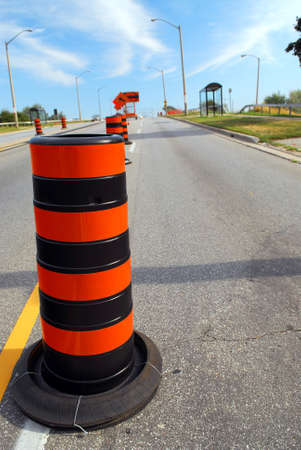 redirect: Road construction signs and cones on city street