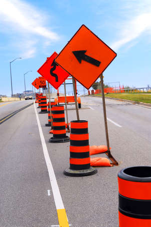 delays: Road construction signs and cones on a city street