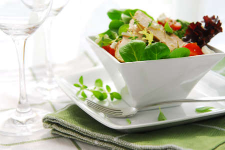 Fresh green salad with grilled chicken herbs and tomatoes photo
