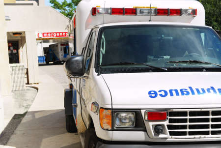 Abmulance vehicle in front of an emergency entrance to a hospital photo