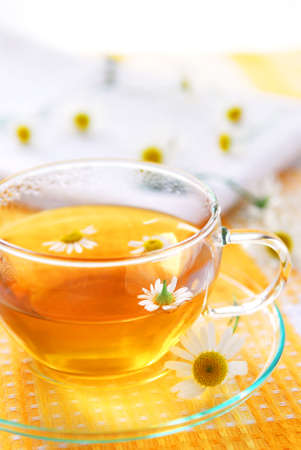 soothing: A teacup with soothing herbal camomile tea