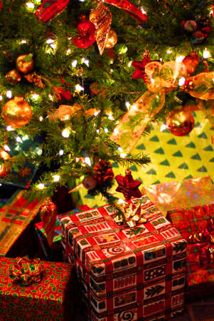 Wrapped gifts under a decorated Christmas tree