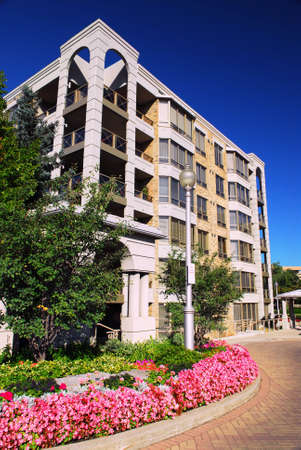 upscale: View of modern upscale condominium building with landscaping