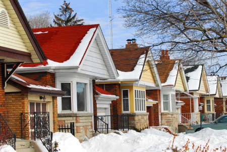 Row of residential houses in winter with snow Stock Photo - 1718833