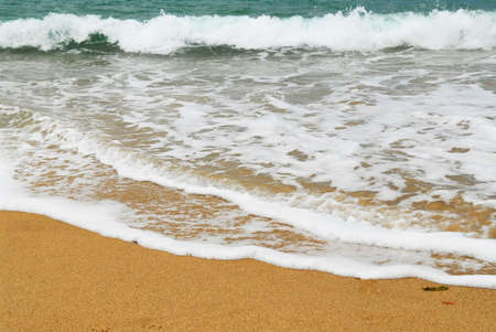 advancing: Ocean wave advancing on a sandy beach