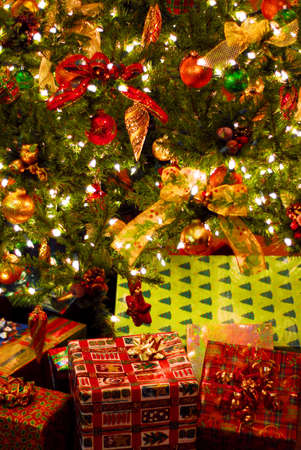 christmas gift: Wrapped gifts under a decorated Christmas tree