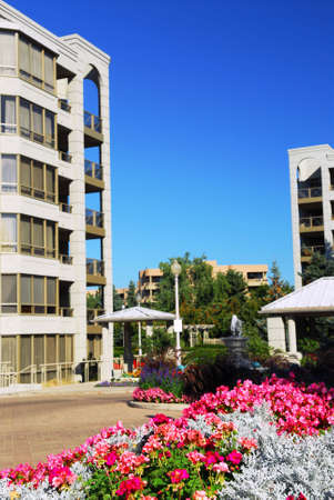 upscale: View of modern upscale condominium buildings with landscaping Stock Photo