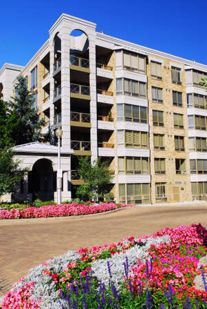 View of modern upscale condominium building with landscaping Stock Photo - 1738261