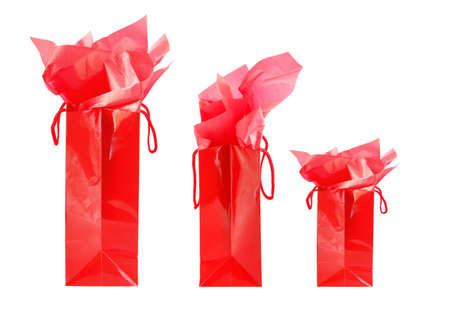 Three red shopping bags isolated on white background photo