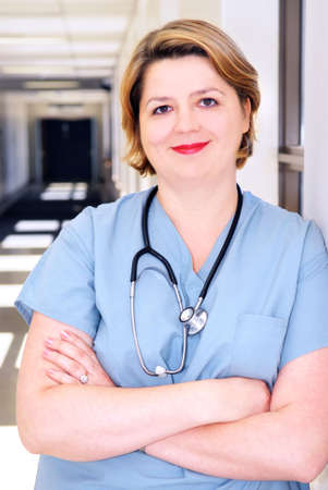 Portrait of a smiling nurse in standing in a hospital corridor Stock Photo - 2053632