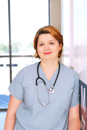 Portrait of a smiling nurse standing in a hospital corridor Stock Photo - 2053627