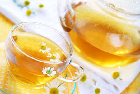 nontraditional: Teacup and teapot with herbal soothing camomile tea