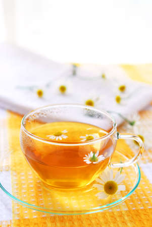 chamomile flower: A teacup with soothing herbal camomile tea