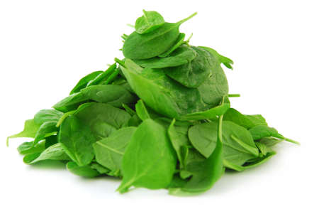 Pile of spinach isolated on white background photo