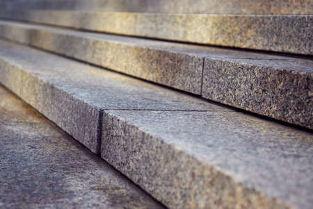 concrete stairs: Close up on granite stairs in perspective with sunlight Stock Photo