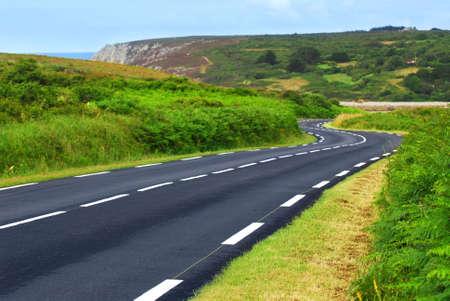 유럽의: Winding road along the ocean coast in Brittany, France 스톡 사진