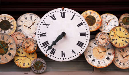 Several antique clock faces of different sizes and styles