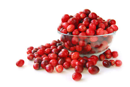 Fresh red cranberries in a glass bowl on white background photo