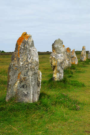 megalith: Row of prehistoric megalithic monuments menhirs in Brittany, France Stock Photo