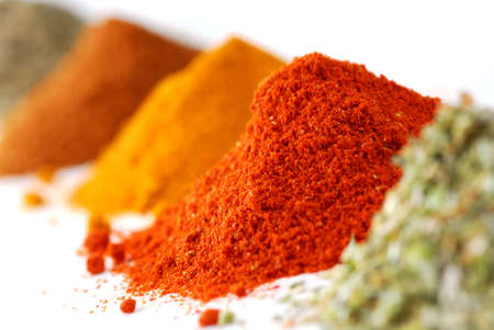 heap: Heaps of various ground spices on white background