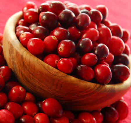 Fresh red cranberries in a wooden bowl Stock Photo - 2257995