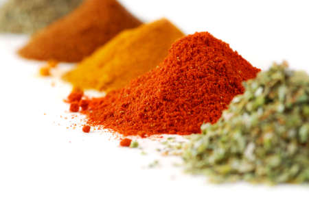 spice: Heaps of various ground spices on white background