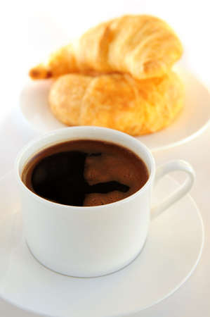 Breakfast of black coffee and fresh croissants Stock Photo - 2338227