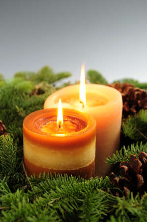 Arrangement of burning Christmas candles and green spruce branches  photo