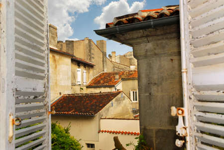 View from an open window with shutters in town of Cognac, France Zdjęcie Seryjne