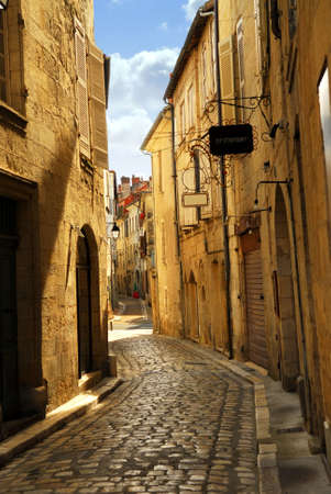 Narrow medieval street in town of Perigueux, Perigord, France photo