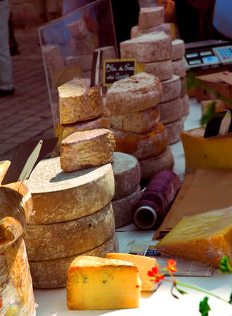 Assorted cheeses for sale on french farmers market in Perigueux, France Stock Photo