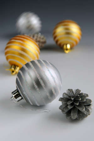 Christmas arrangement with glass bauble ornaments and pine cones