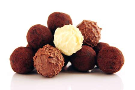 Pile of assorted chocolate truffles isolated on white background photo